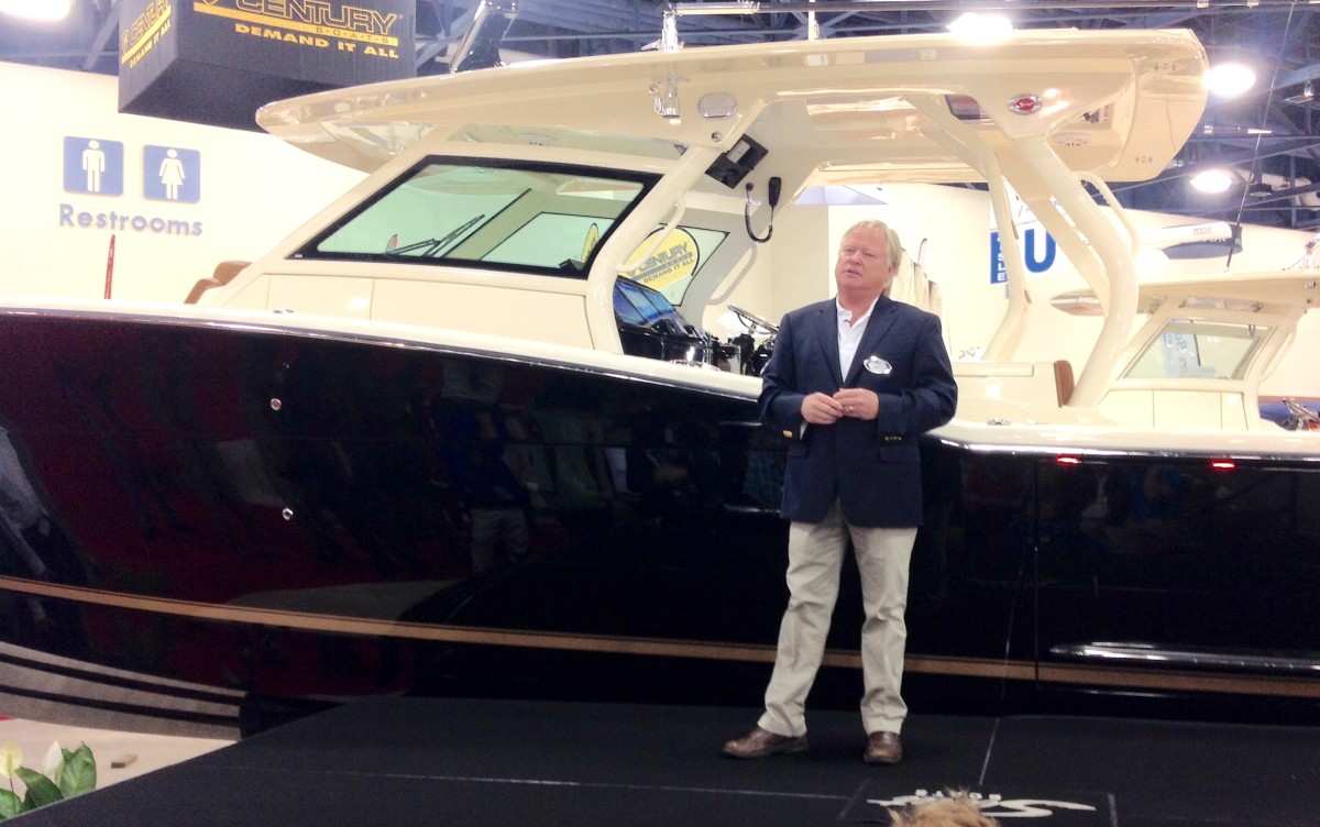 Scout Boats president Steve Potts stands in front of the Scout 420 LXF center console.