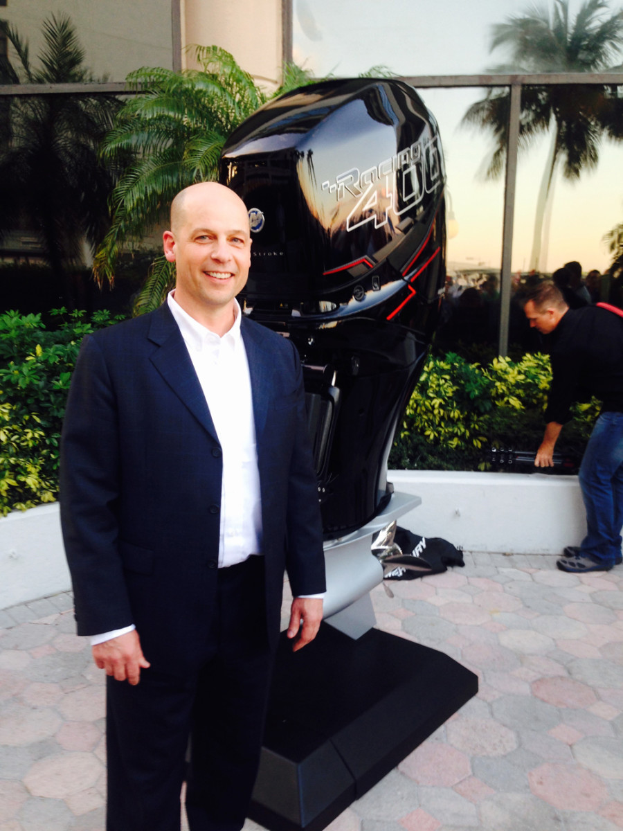 Mercury president John Pfeifer is shown with Mercury Racing's new Verado 400R, a racing engine that also can be used for high-performance recreational boats, including offshore center consoles.