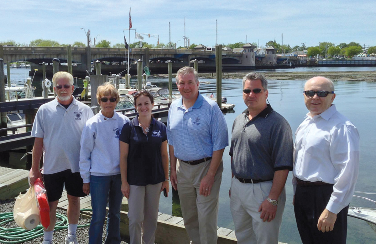 Danko and New Jersey Assemblyman David Rible (third from right) pay a post-Sandy visit to Main One Marina in Avon by the Sea.