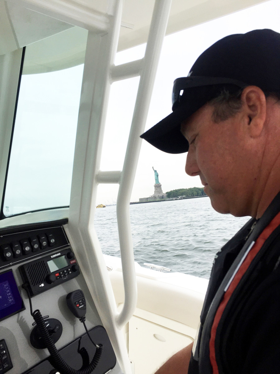 Capt. Travis Hayes demonstrated the controls to media members from Forbes, Fortune, Popular Mechanics and other mainstream publications who had little or no boating experience on Monday near the Statue of Liberty.
