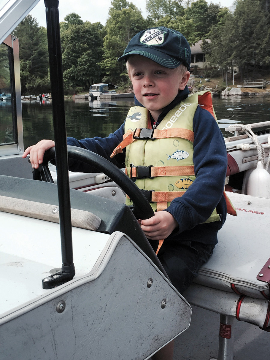 Walz's son Ben, 6, takes a turn at the helm.