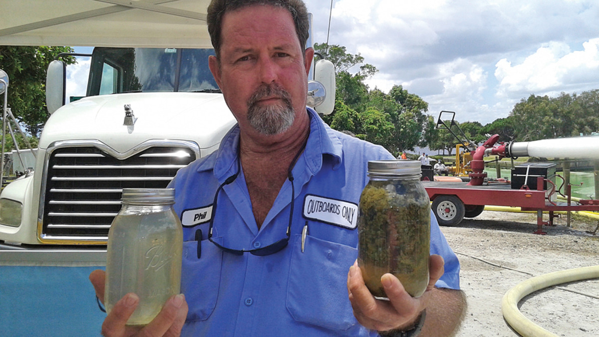 Ecosphere Technologies spent eight days cleaning up at Outboards Only. Phil Norman, a partner in the business, holds before and after samples.