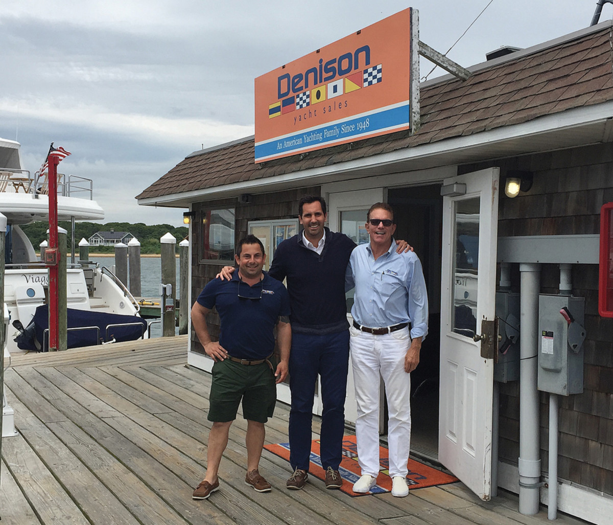 "Bob Denison stands with broker Mike Fine (left) and his uncle, broker ""Skip"" Denison (right), outside the Montauk, N.Y., office."