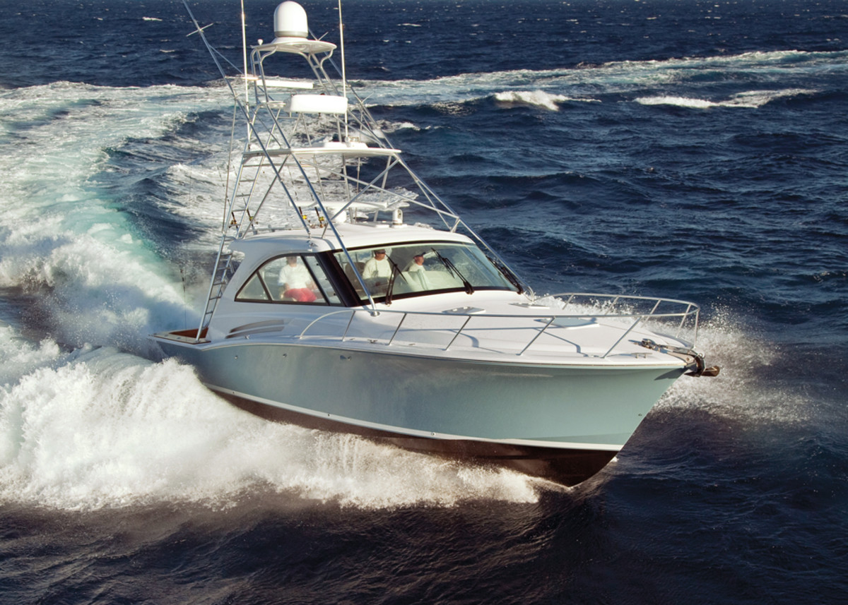 Denison carries a number of well-known brands, including Hatteras Yachts. Here, a 45-foot Hatteras charges through the ocean.