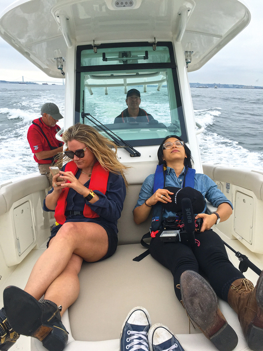 Sally Turner (left) and Mia Fermindoza take time out from streaming to Facebook to enjoy the ride. Mercury hopes their reporting will attract more millennials to boating.