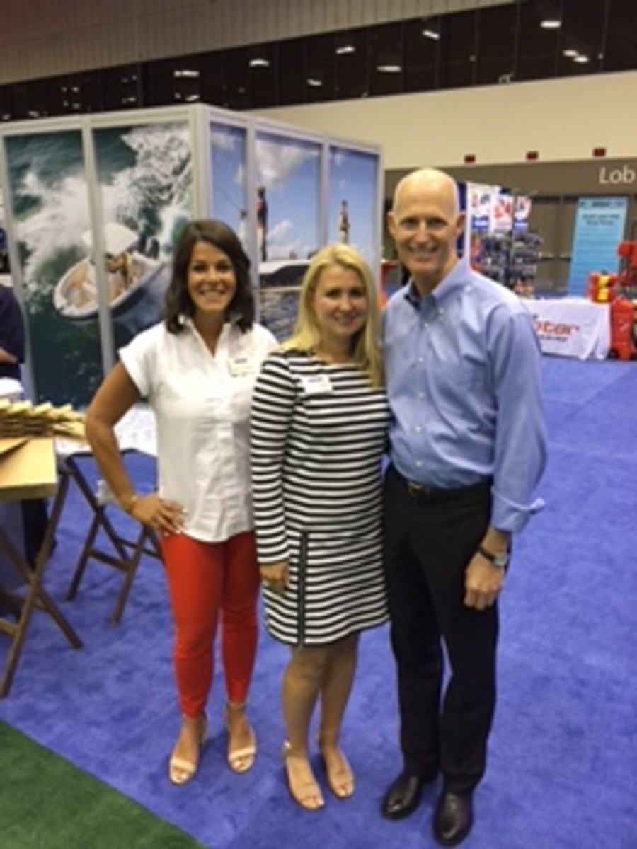 Florida Gov. Rick Scott is shown with (from left) Nicole Vasilaros, vice president of federal and legal affairs at the NMMA, and Jen Thompson, the NMMA's vice president of consumer and trade events.