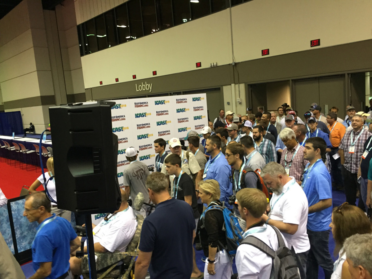 Media members flooded into a display area on Tuesday to check out the new fishing equipment from ICAST exhibitors during a preview of the New Product Showcase.