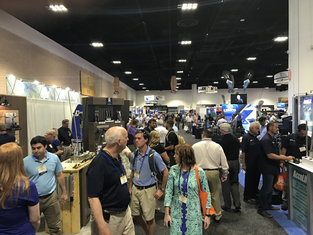 Attendees walk the aisles at IBEX on Tuesday. Organizers expect to attract more international exhibitors and conferees to IBEX in future years.