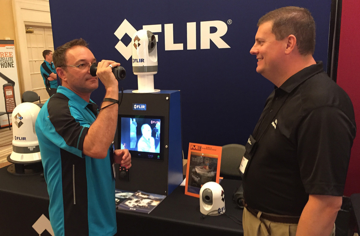Jesse Revilla (left), account manager for Global Ocean Security Technologies (GOST), checks out FLIR's Ocean Scout TK thermal imaging camera with the assistance of Jim McGowan, FLIR Maritime of the Americas marketing manager, at the NMEA's International Marine Electronics Conference & Expo in Naples, Fla.
