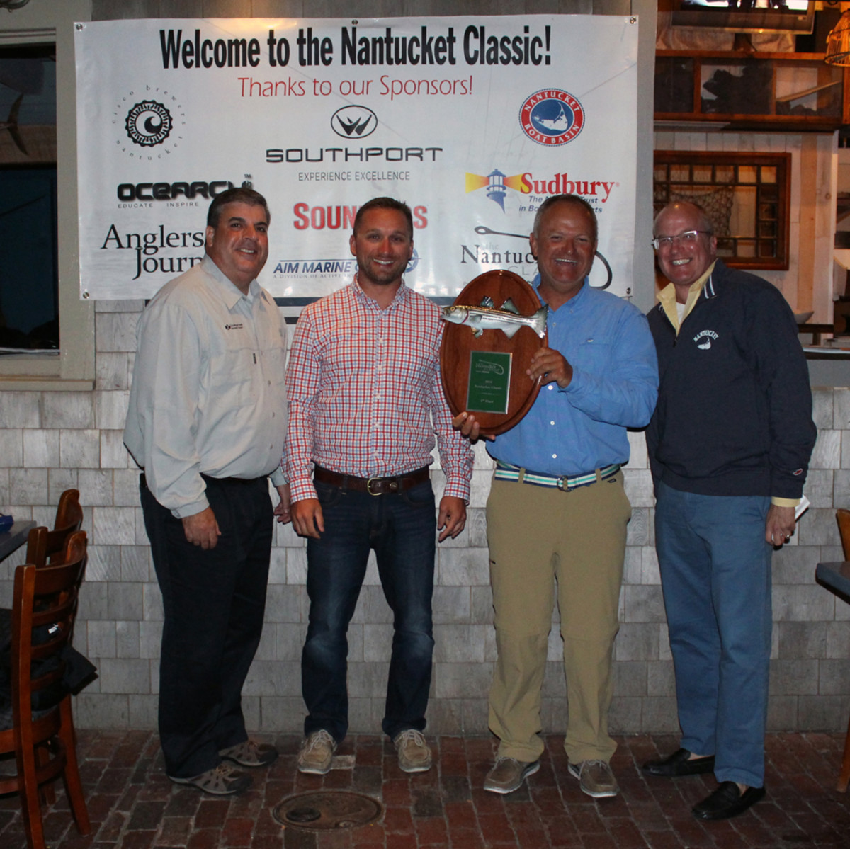 The Nantucket Classic tournament, sponsored by Southport and Soundings, was held Sept. 23-24. Shown are David Rose, (left), angler on the winning boat Summer Place (a Southport 33 FE); Southport's marketing manager, Jonathan Kirby; first-place winner and Summer Place owner Rob Miller; and Soundings publisher Paul Smith.