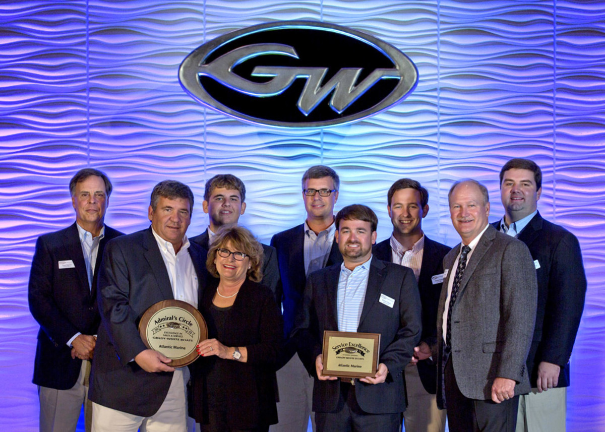 Grady-White Boats president Kris Carroll (front row, left) and sales vice president Joey Weller (front row, right) present awards to dealers.