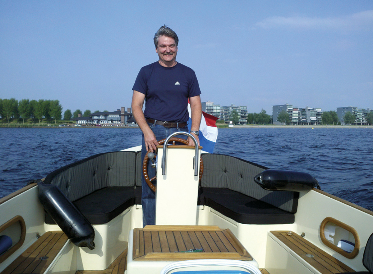 McKnight loves to get out on the water. Here he pilots a sloop in Holland.