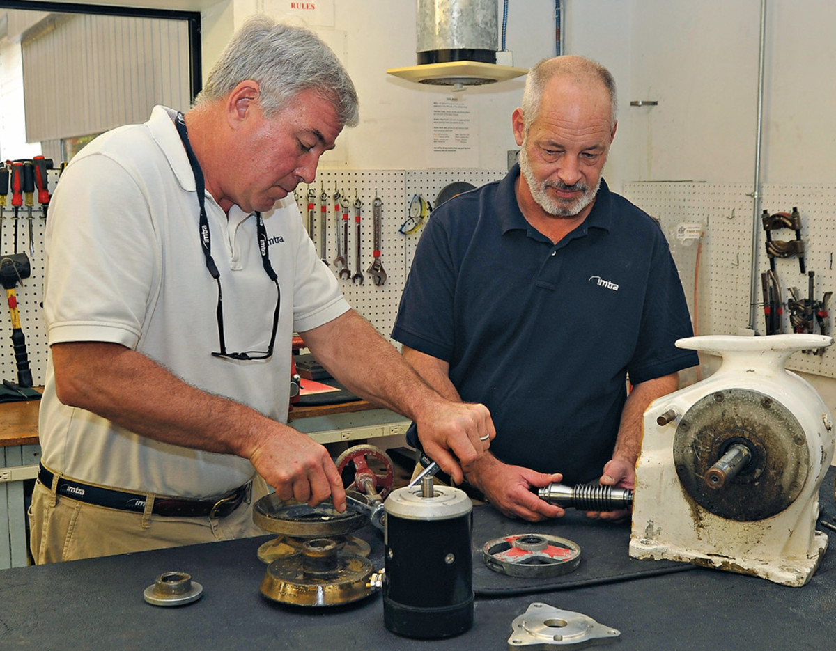 Imtra's Jim Thomas (left) and Mark Raeder perform maintenance on a windlass.