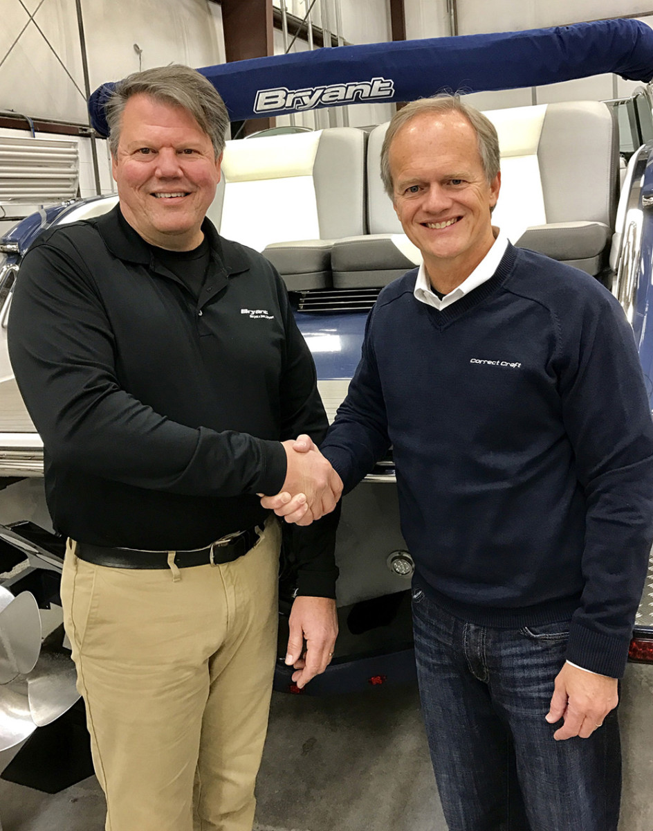Correct Craft CEO Bill Yeargin (right) is shown with John Dorton, who will remain at Bryant Boats as president and a minority shareholder.