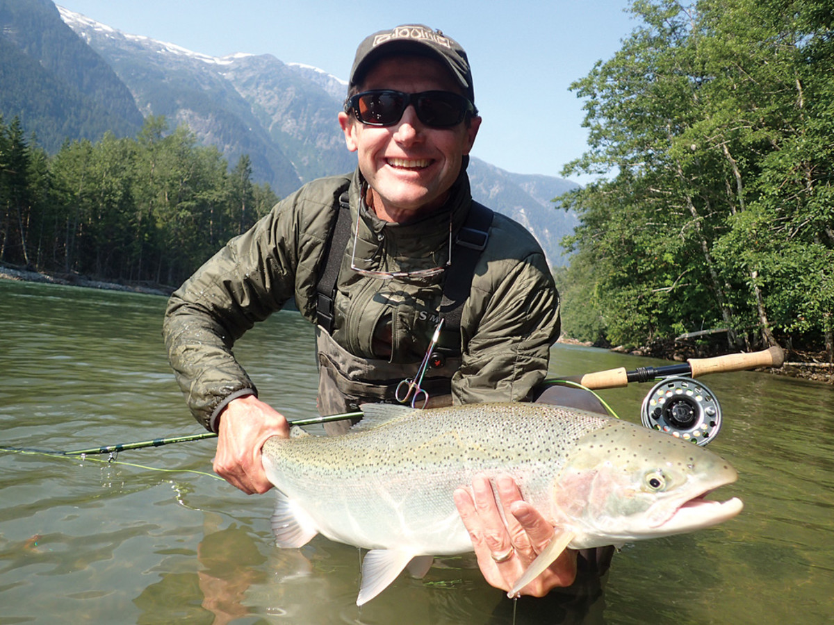 Harris shows off a steelhead pulled from the Dean River in British Columbia.