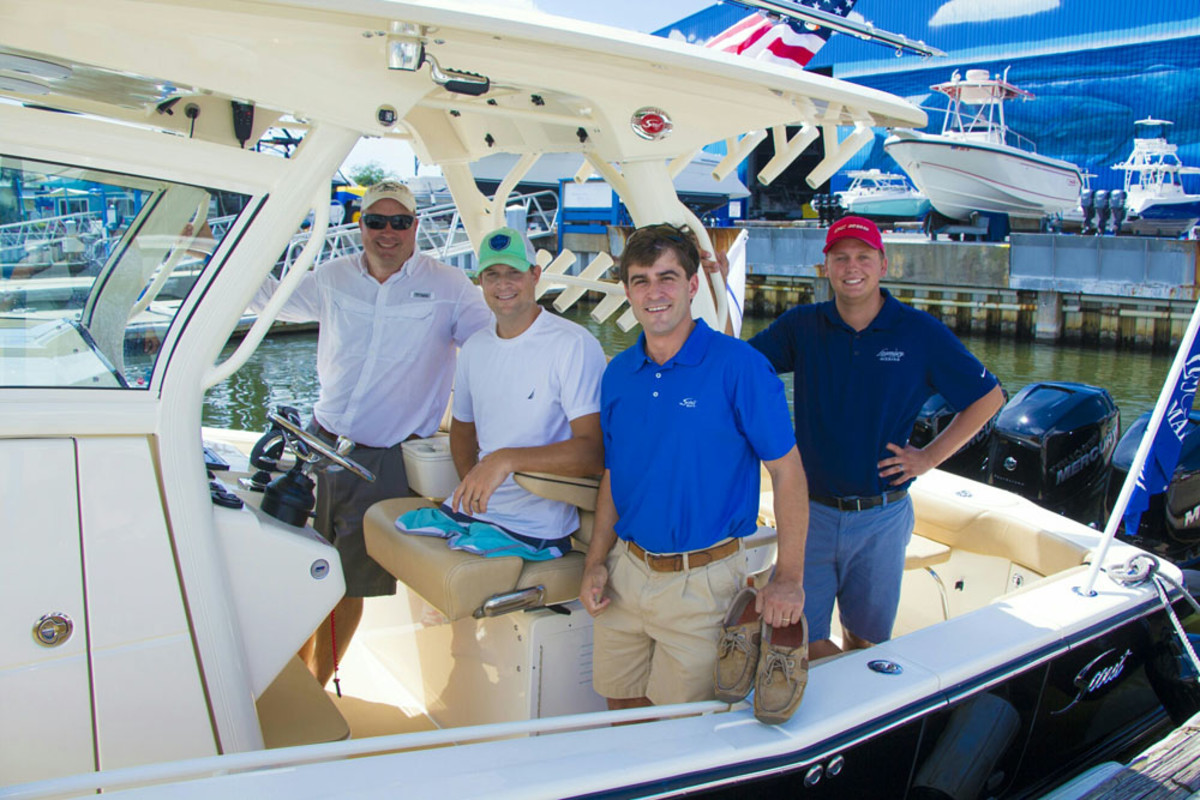 Scout Boats built a 350 LXF luxury center console for Senior U.S. Airman Brian Kolfage (second from left), who survived a rocket attack on an air base in Iraq.