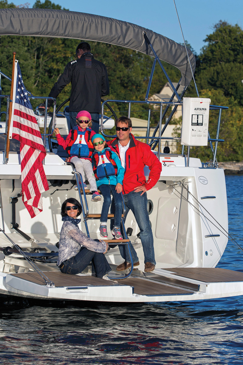 Harvey and his family enjoy the water, getting out as often as time permits. Here they relax on the stern of a Jeanneau 64.