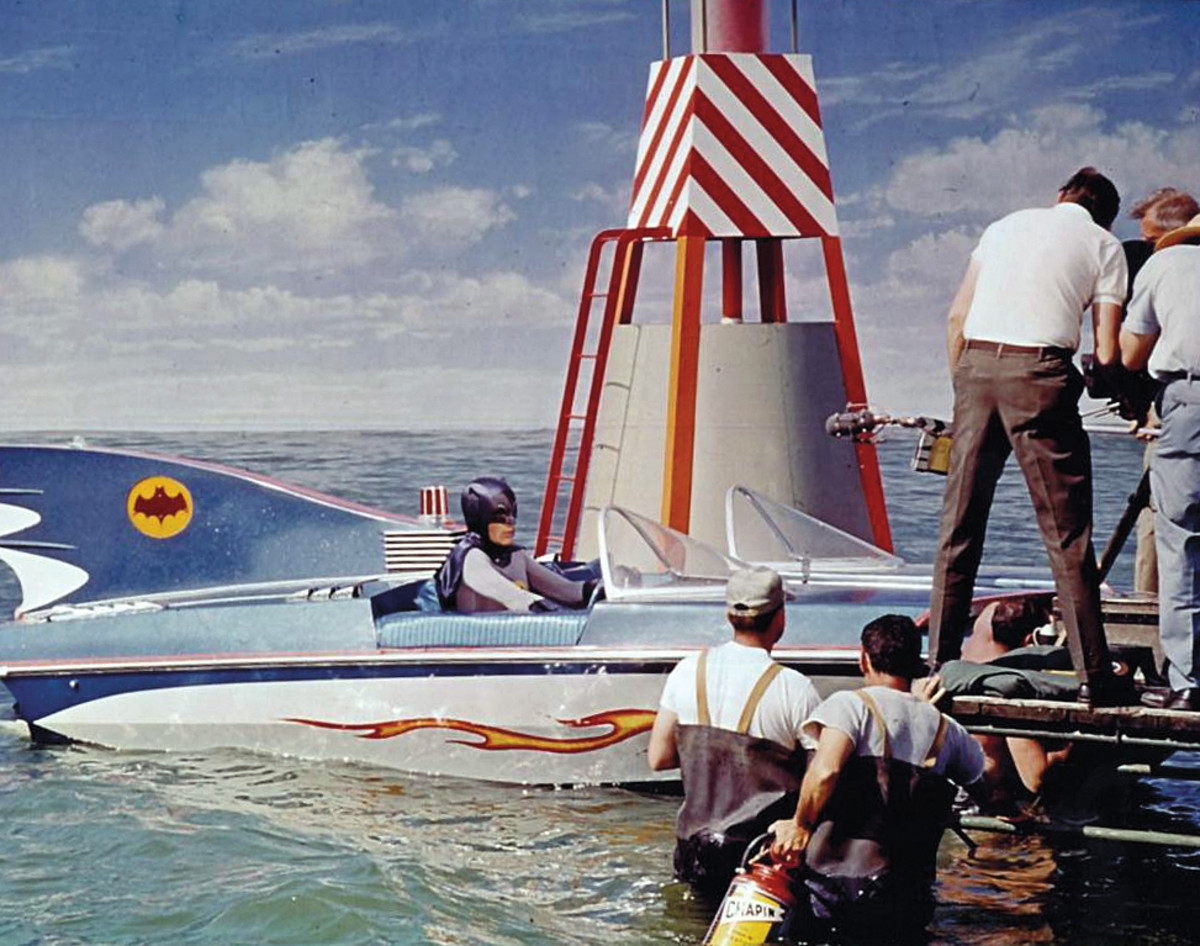 The original Batboat was designed from a Glastron V-174, complete with flashing beacon and glowing eyes and a tail fin Bat signal.