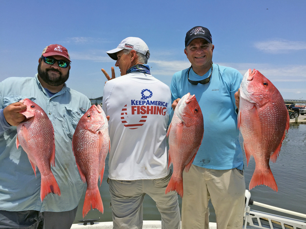 Hughes enjoys the short red snapper season with Chris Macaluso (left) of the Theodore Roosevelt Conservation Partnership and Gary Jennings (right) of Keep Florida Fishing.