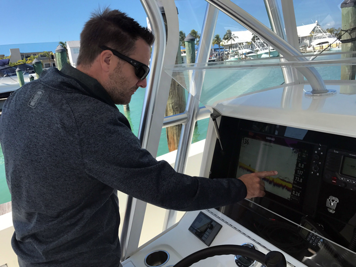 Mark Griffith, Navico product manager for multifunction displays and saltwater sonar, operates a Simrad MFD now equipped with higher resolution through a technology called in-plane switching (IPS).