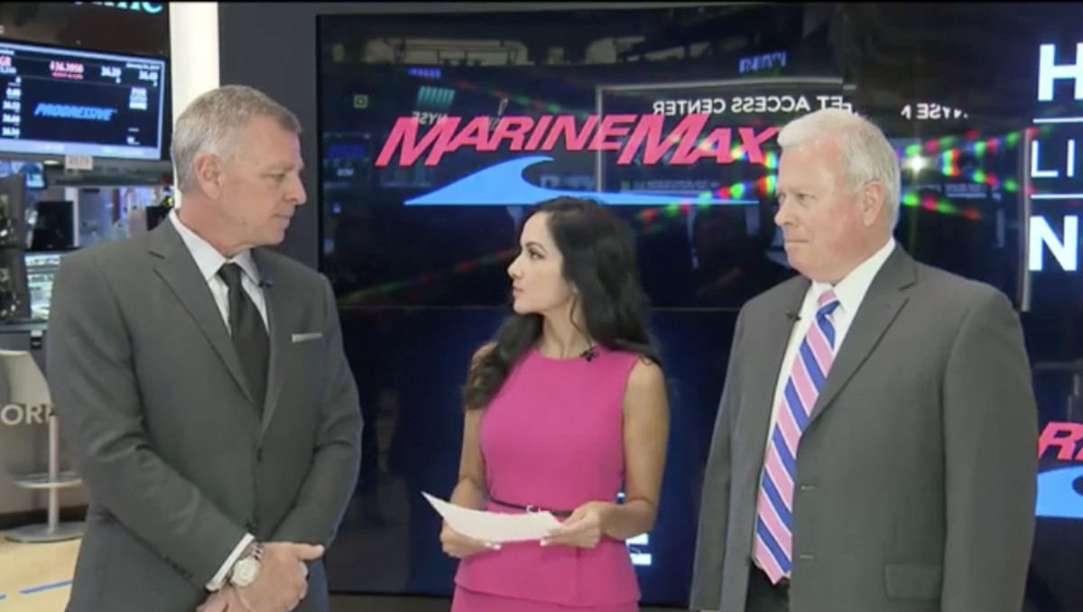 MarineMax chief revenue officer Chuck Cashman (left) and National Marine Manufacturers Association president Thom Dammrich are shown during the interview with Judy Shaw on the floor of the New York Stock Exchange.