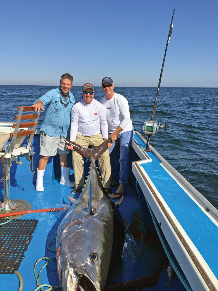Hughes (right) with Chris Megan (left), On The Water publisher; and Pure Fishing CEO and president John Doerr (center), who caught this bluefin tuna off Prince Edward Island.