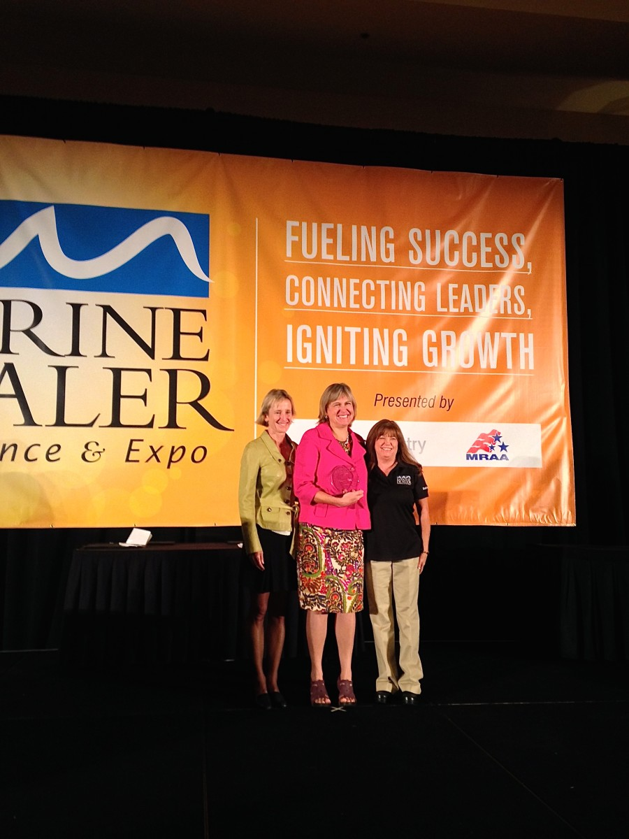 BoatUS president Margaret Podlich (center) is the winner of the 2014 Darlene Briggs Woman of the Year Award. She is shown with Volvo Penta's Marcia Kull (left), a former winner, and Boating Industry magazine's Kathy Johnson.
