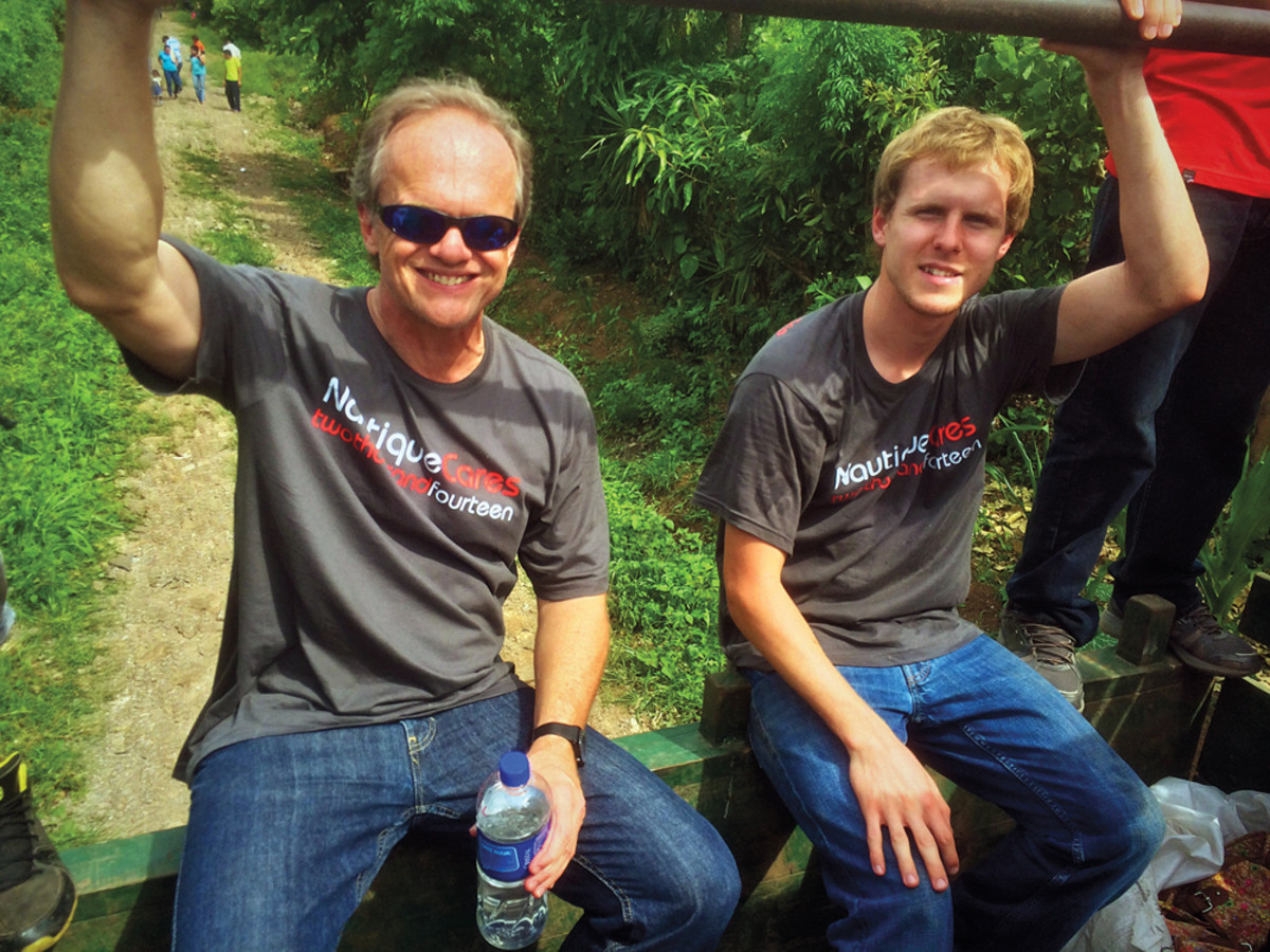 Yeargin, with employee Ben Drew, on a service mission to El Salvador.