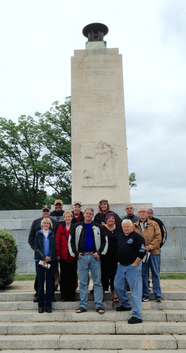 Tour riders are shown at the Eternal Light Peace Memorial in Gettysburg.