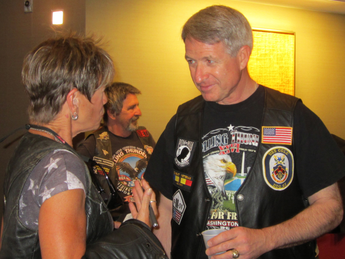 Tour rider and writer Marilyn DeMartini interviews Navy Cmdr. Kirk Lippold (Ret.), former commanding officer of the USS Cole.