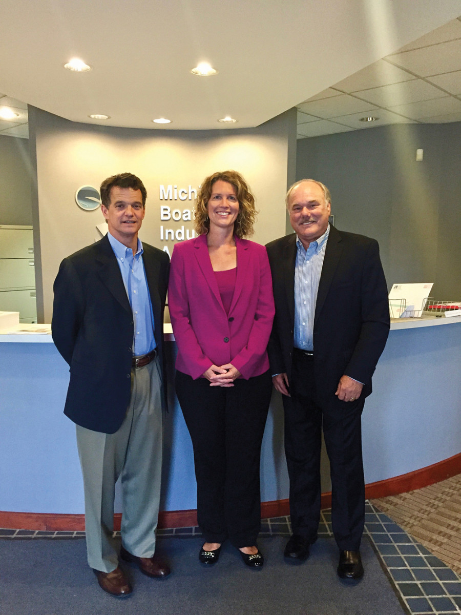 U.S. Rep. Dave Trott, R-Mich., visits with Coburn and Michigan Boating Industries Association executive director Nicki Polan at MBIA headquarters.