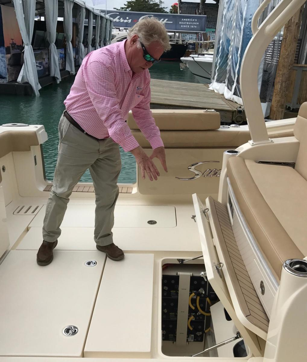 Introducing the Scout Boats 380 LXF, company president Steve Potts points to its gyroscope.