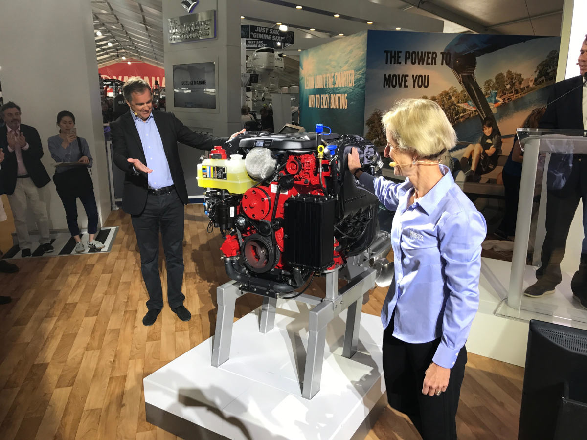 Bjorn Ingemanson (left) global president of Volvo Penta, and Marcia Kull, vice president of marine sales for Volvo Penta of the Americas, unveil the company's latest sterndrive gasoline engine.