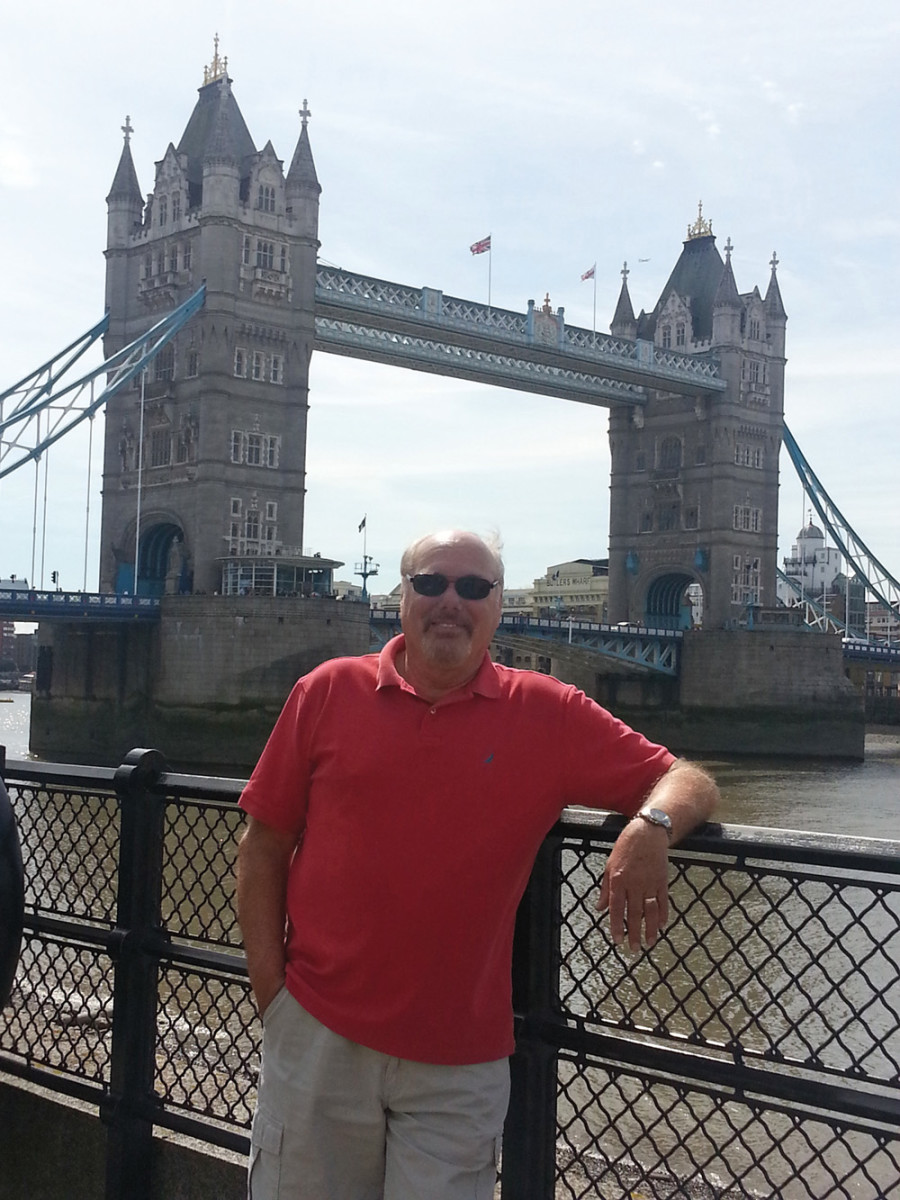Coburn, with London's Tower Bridge in the background, visited England last August on a family vacation.