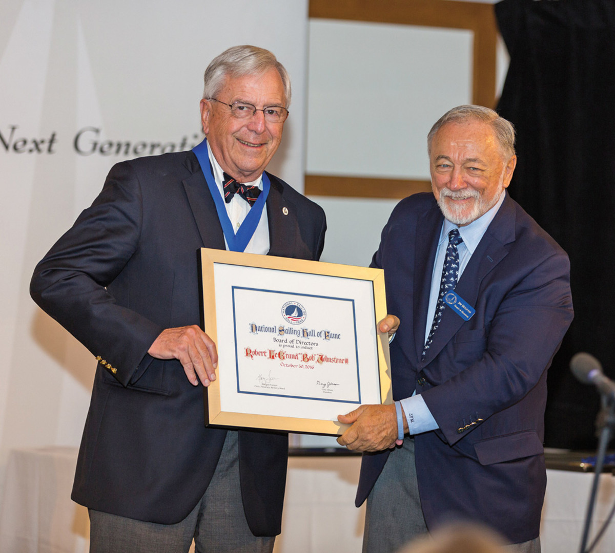 Bob Johnstone (left) gets his certificate from National Sailing Hall of Fame vice president Jim Muldoon.