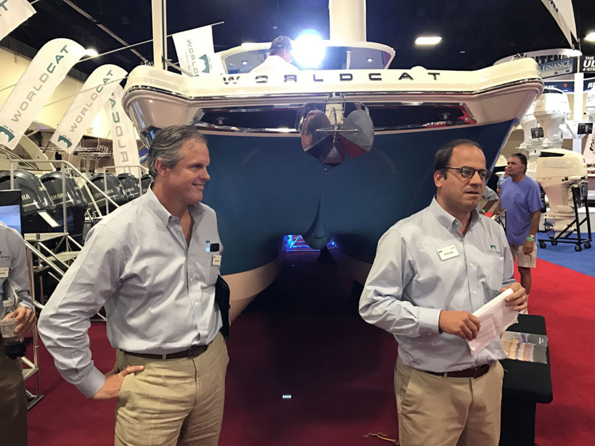 World Cat president Andrew Brown (left) and national distribution manager Wyatt Lane talk about the first in a new breed of catamarans for the North Carolina builder — the World Cat 280CC-X.