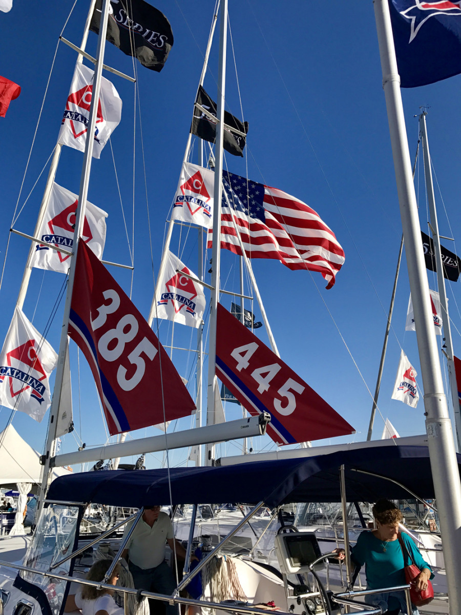 "Catalina Yachts salesmen closed deals on two boats Friday at the show. ""I think buyers were nervous before the November election, and now they're confident and relaxed and are in a buying mood,"" Catalina materials manager Patrick Turner said."