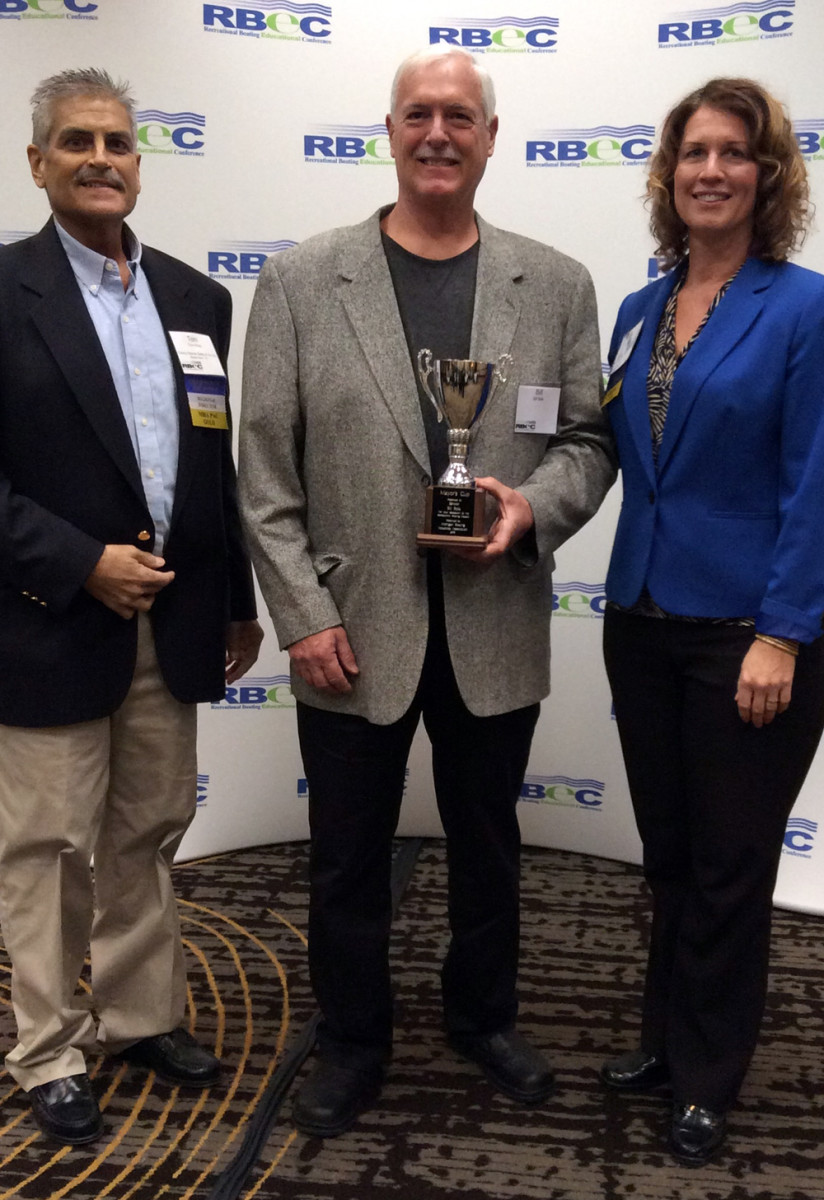 Bill Boik (center) received the 2016 Mayor's Cup Award from the Michigan Boating Industries Association. He is shown with MBIA chairman Tom Haag and MBIA executive director Nicki Polan.
