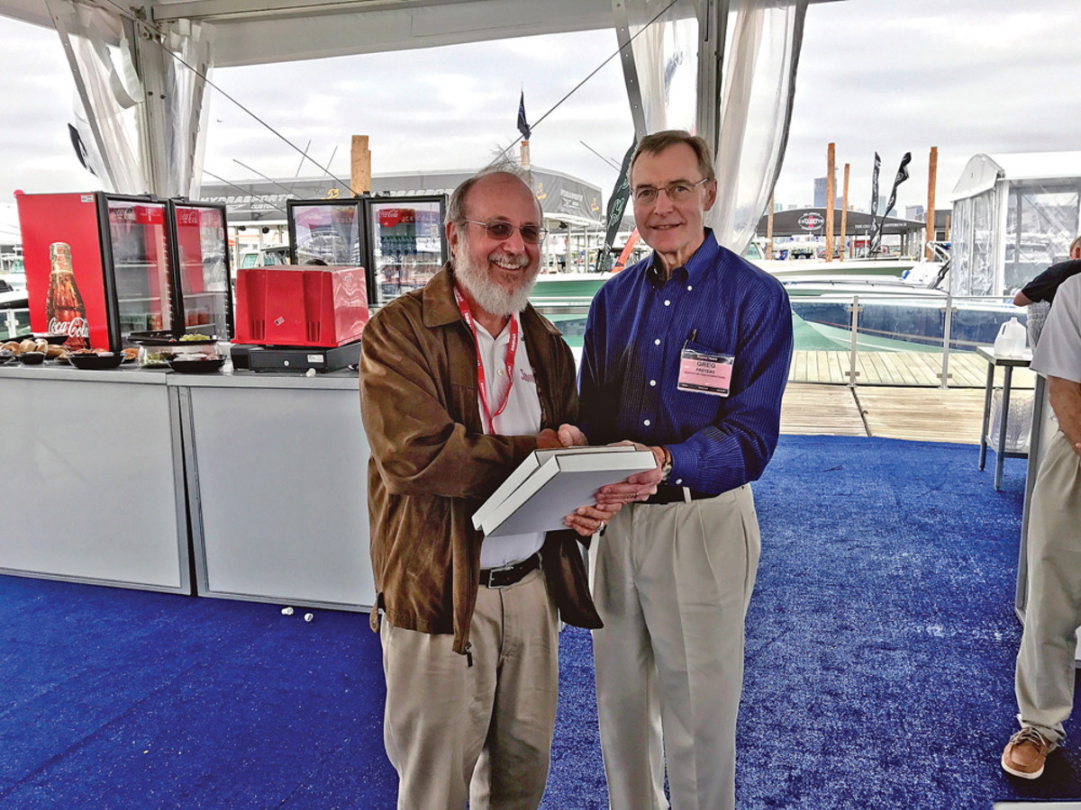 Soundings and Anglers Journal senior writer Jim Flannery accepts one of his four awards from BWI's Greg Proteau.