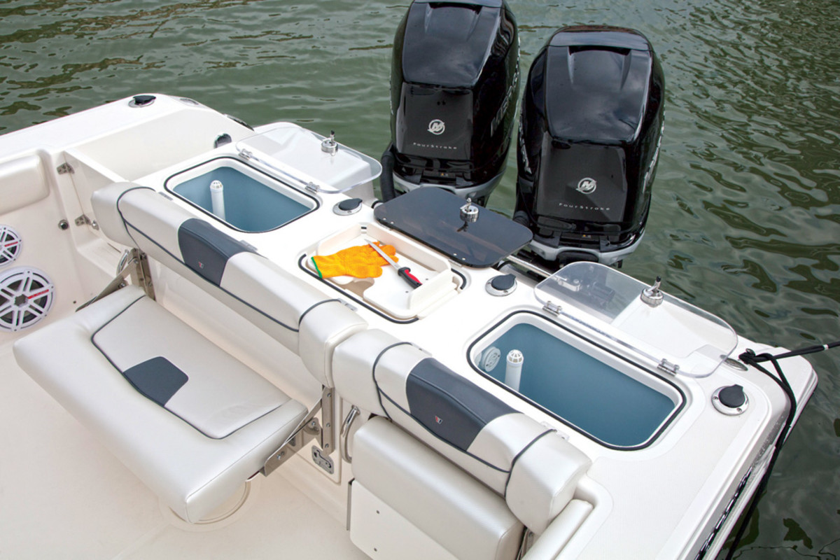 The 302 has dual live wells, a fish box and other fishing amenities.