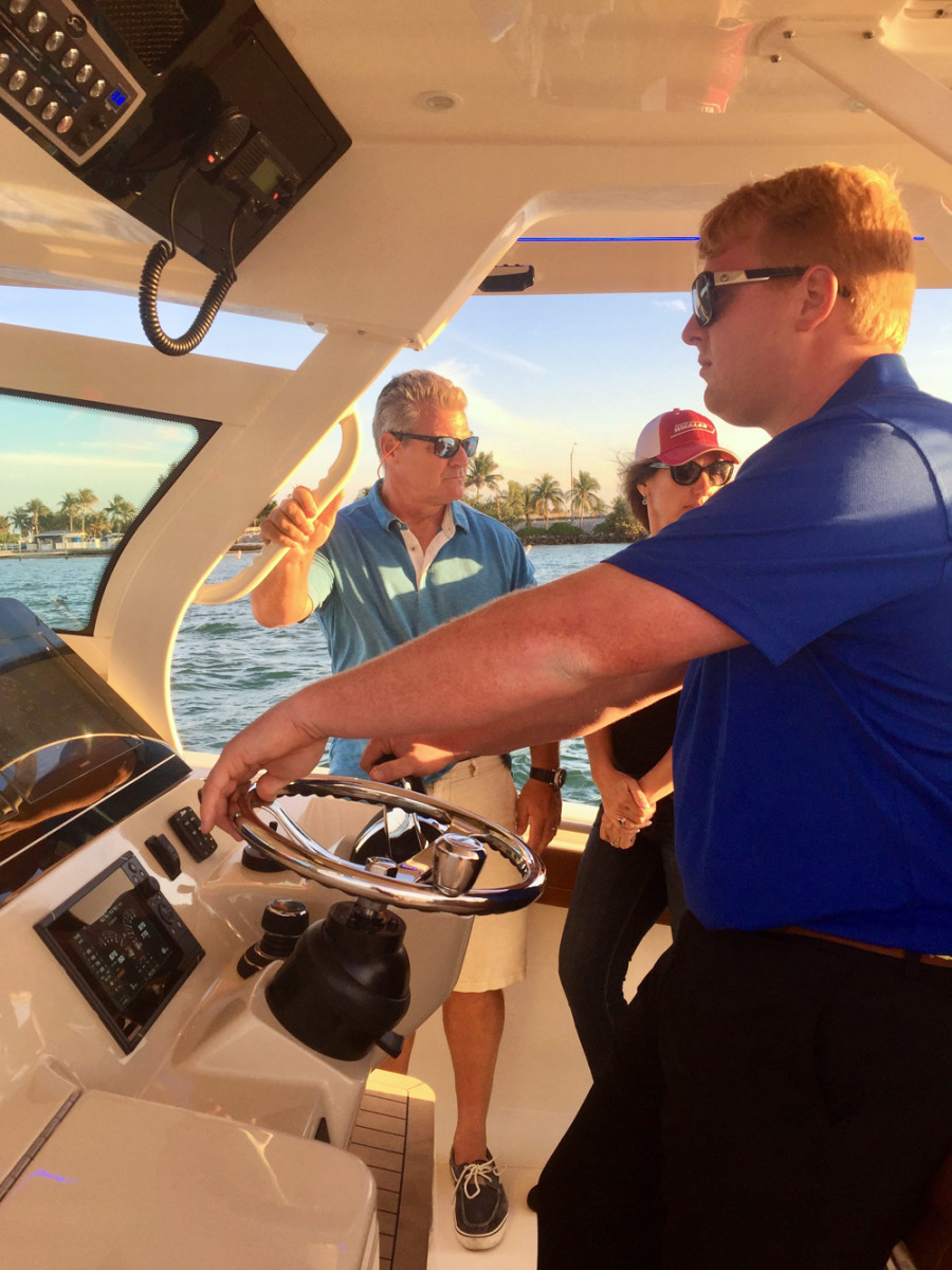 A couple looked at upgrading from a smaller center console to the Scout 380 LXF on Friday at the Miami International Boat Show.