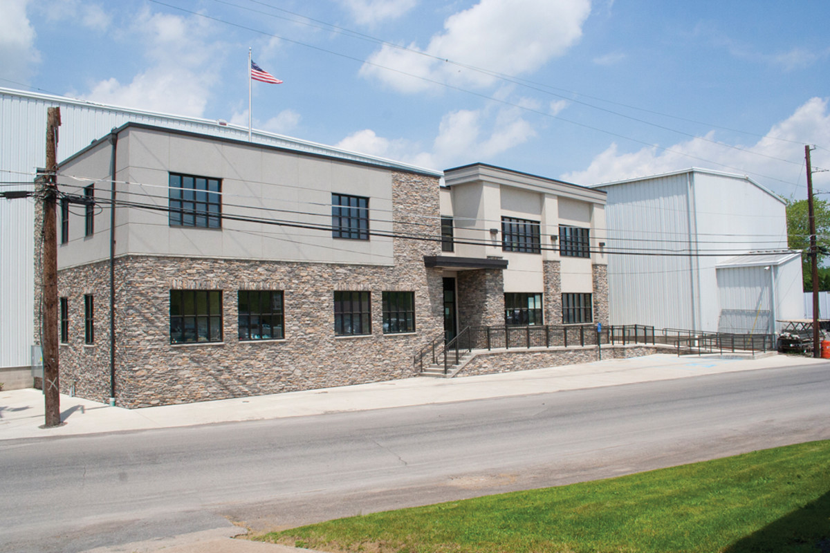 A new warehouse opened in June 2014 — 15 months after fire destroyed the company's old facility.