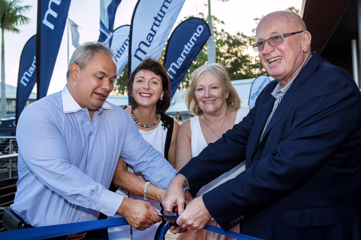 Gold Coast Mayor Cr Tom Tate (left) and Mayoress Ruth Tate are shown cutting the ribbon to officially open Maritimo's new waterfront facility on Feb. 8 with Bill and Lesley Barry-Cotter.