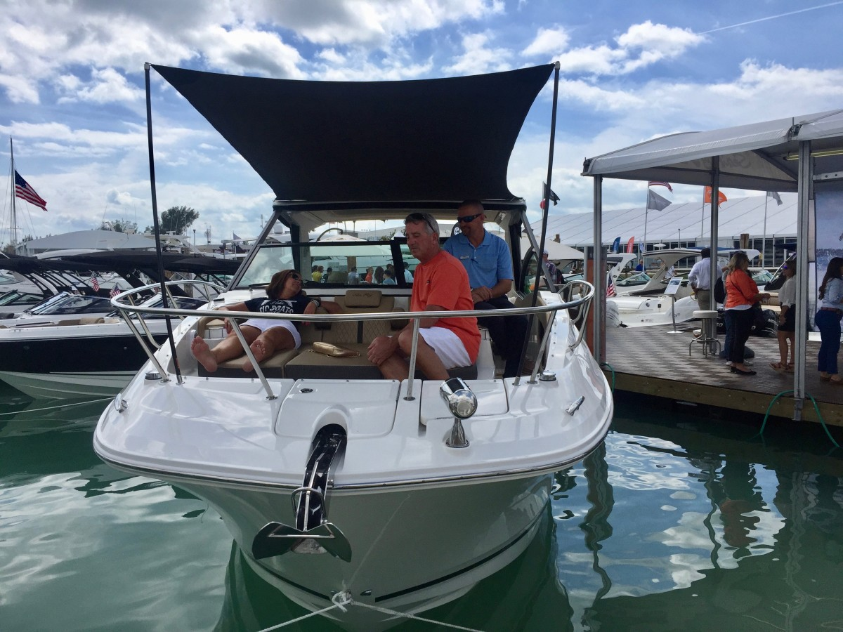 Miami International Boat Show visitors check out Sea Ray's new Sundancer 320.