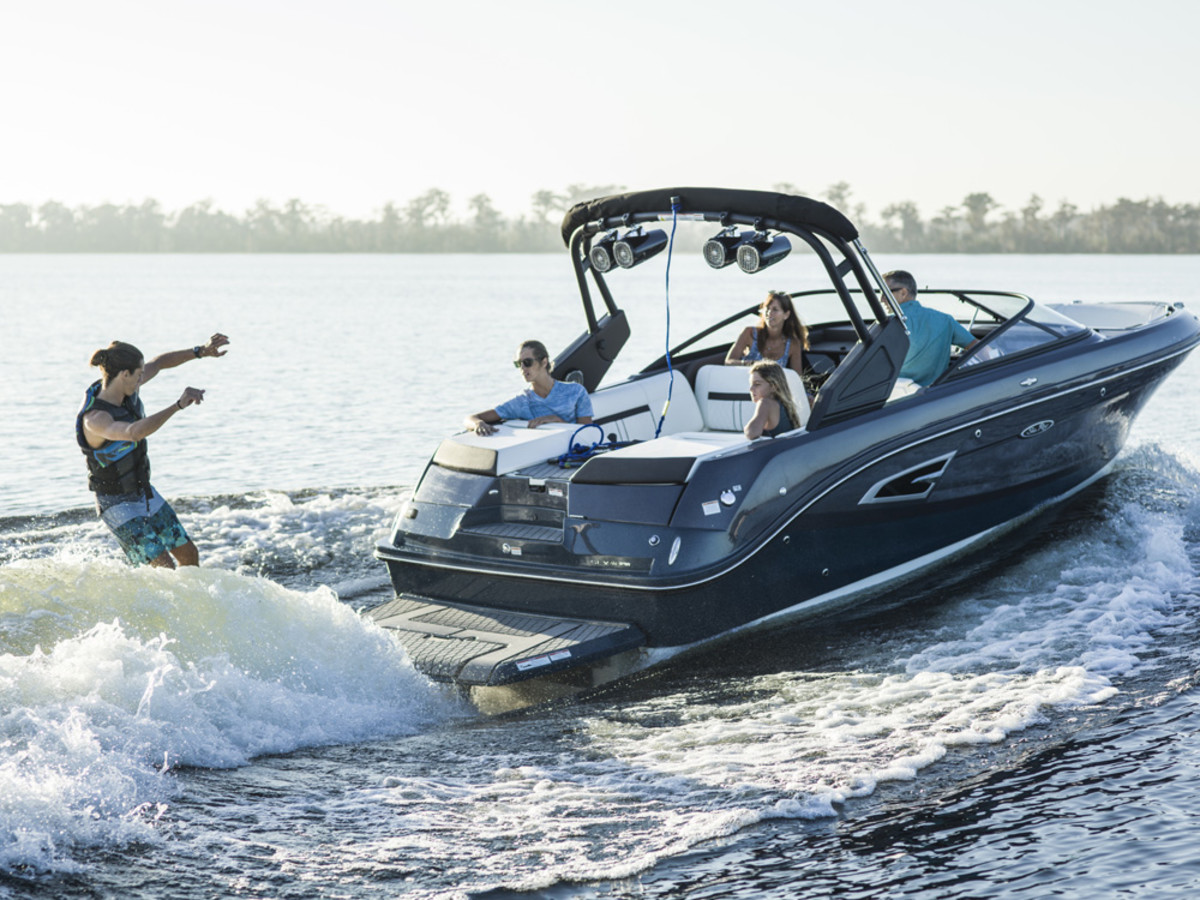 Sea Ray said its new SLX-W 230 combines wake-shaping capabilities with a deep-vee hull design, joystick piloting capability, a submersible swim step, Dynamic Display and a standard watersports tower.