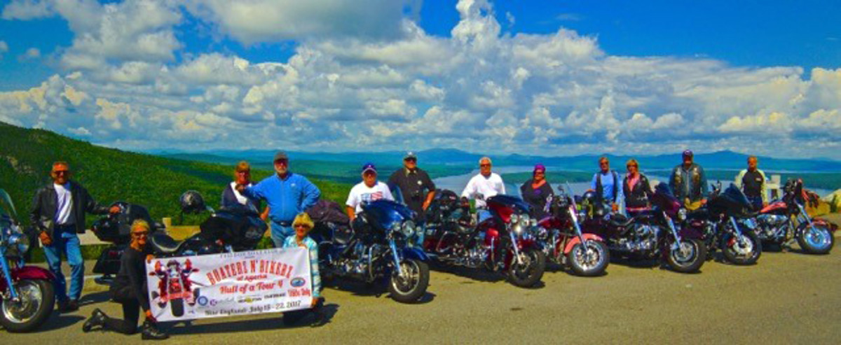 Tour riders stopped Sunday at the Height of Land observation station on top of Spruce Mountain in Rangeley, Maine.