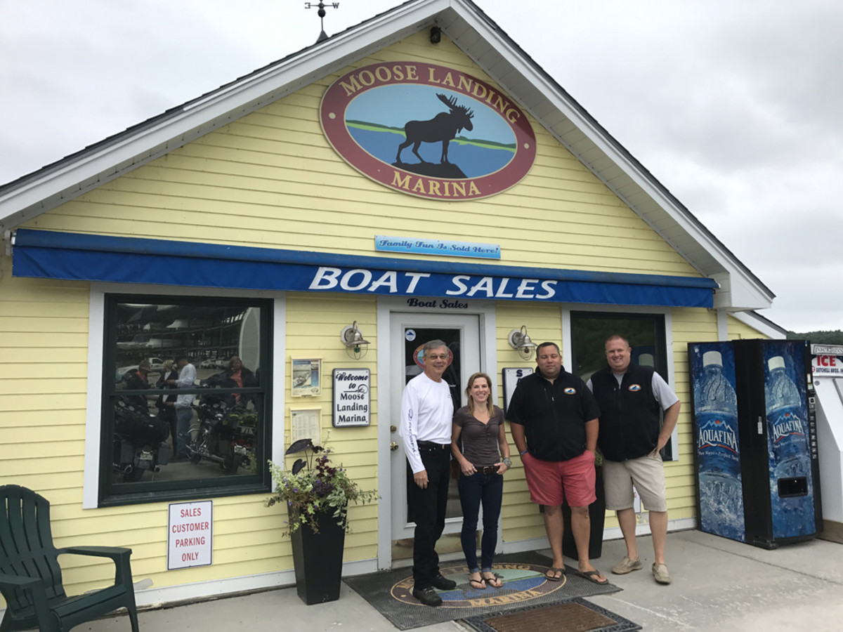 Jim Krueger (left), regional sales manager for Regal Boats, and Moose Landing Marina managers welcomed the riders and launched the tour.