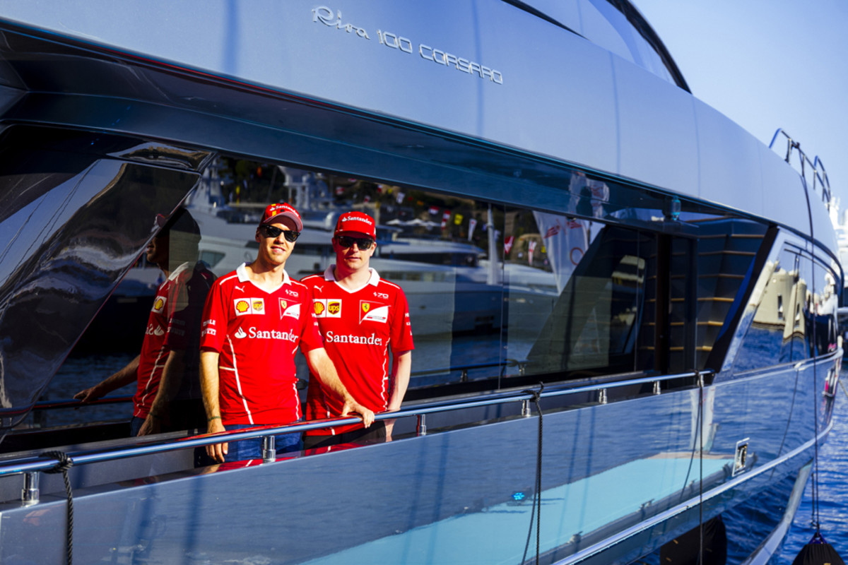 Scuderia Ferrari Formula One drivers Sebastian Vettel (left) and Kimi Raikkonen are shown aboard the Riva 100' Corsaro. Riva sponsors the Scuderia Ferrari Formula 1.