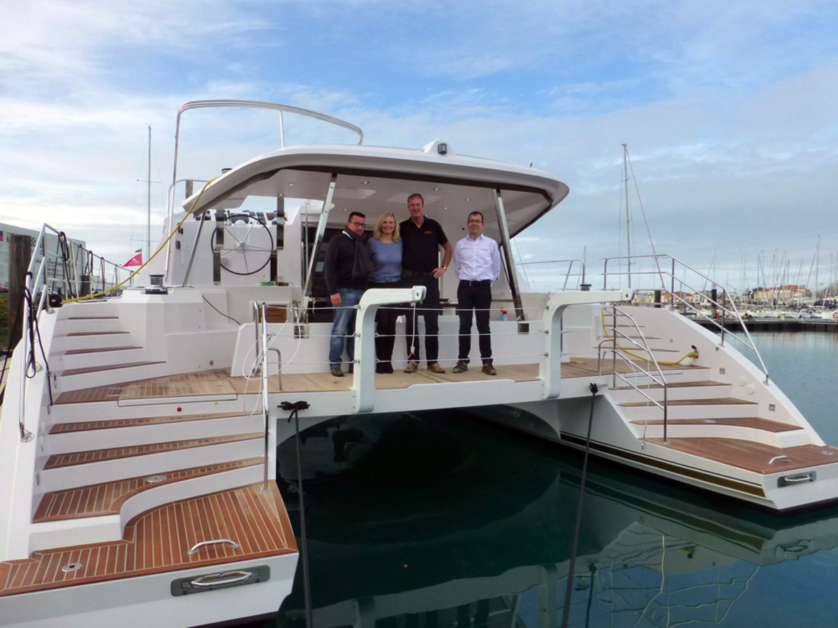 Privilege Marine CEO Gilles Wagner (left) is shown with the future owners of the first Privilege Series 5 Hybrid Catamaran and Torqeedo's Ulf Kanne (right).