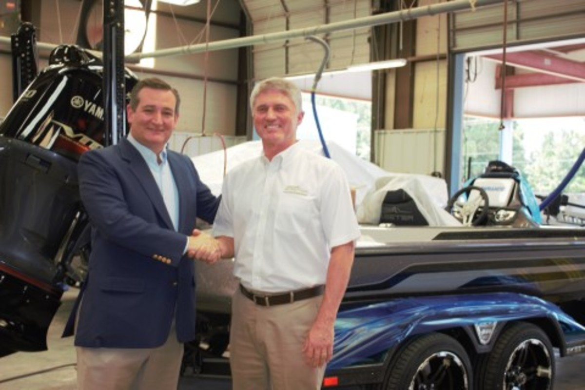 U.S. Sen. Ted Cruz (R-Texas), (left), meets with Jeff Stone, senior vice president of Skeeter Products Inc., during a visit to the Skeeter Boats facility in Kilgore, Texas.